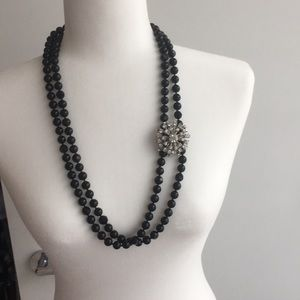Black beaded necklace with removable broach